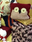 Hand knitted and fabric cushions